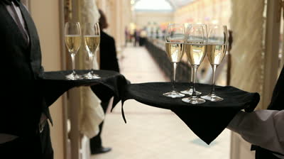 stock-footage-waiters-holds-a-trays-with-glasses-of-champagne-at-reception